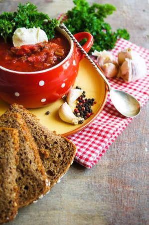 Traditional ukrainian soup - borsch, on the woodenn table