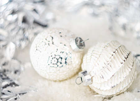 Foto de Christmas holiday concept with balls on bright background with copy space - Imagen libre de derechos