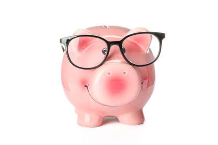 Foto de Happy piggy bank with glasses isolated on white background. Finance, saving money - Imagen libre de derechos