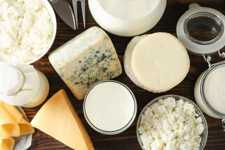 Photo for Different dairy products on wooden background, top view - Royalty Free Image