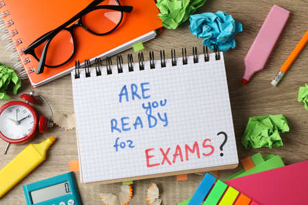 Photo pour Inscription Are you ready for exams? and different stationary on wooden background, top view - image libre de droit
