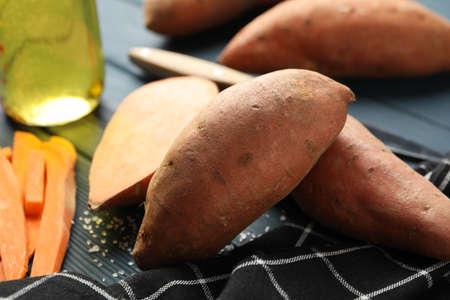 Photo pour Sweet potato and ingredients on wooden background, close up - image libre de droit