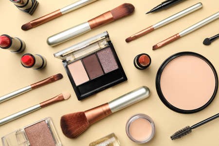 Photo for Different makeup cosmetics on beige background. Female accessories - Royalty Free Image