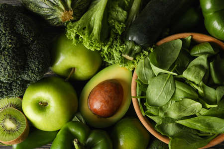 Photo for Green vegetables and fruits on wooden background, top view - Royalty Free Image