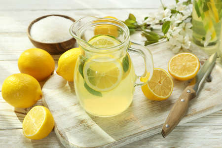 Photo for Concept of fresh summer drink with lemonade on white wooden table - Royalty Free Image
