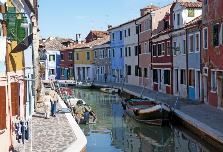 Venice, Burano island canal,  colorful houses and  boats
