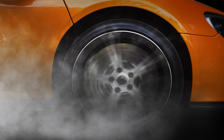 Photo pour Detail of a sport car with spinning wheel, smoking, doing drifts and burnouts - image libre de droit