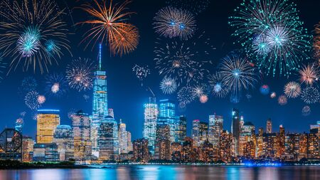 Photo pour New Years Eve with colorful Fireworks over New York City skyline long exposure with beautiful dark blue sky, sci-fi orange city light glow and reflections in the river - image libre de droit