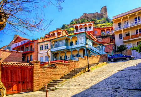 Traditional carved balconies and colorful wooden houses in the Old Town of Tbilisi, Georgia