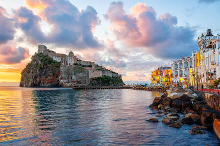 Photo pour Historical Aragonese castle on a rock in Mediterranean sea, Ischia island, Gulf of Naples, Italy, in dramatic sunrise light - image libre de droit