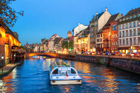 Foto de A touristic boat on a historical canal in Strasbourg Old town, Alsace, France - Imagen libre de derechos