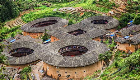 Traditional earthen Tulou Chinese huts, a landmark tourist attraction from the Fujian province of China. These large round huts are still being lived in today by the Hakka people.