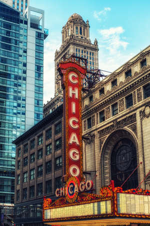 'Chicago, Illinois, USA - June 18, 2017: With its large electric sign, the Chicago Theatre, opened in 1921, is an iconic State Street landmark in downtown Chicago.'