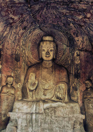 Luoyang, Hernan, China-December 25,2017 : A carved stone Buddha, carved from the rock, Longmen Grottoes and Caves, Luoyang, Henan Province, China