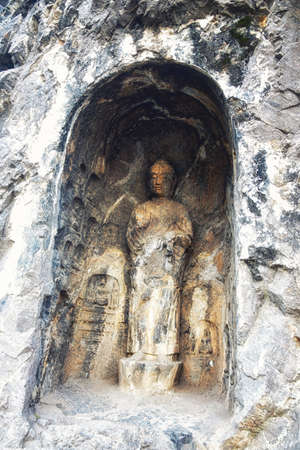 Luoyang, Hernan, China-December 25,2017 : Carved Buddha images at Longmen Caves, Dragon Gate Grottoes, dating from the 6th to 8th Centuries, UNESCO World Heritage Site, Henan Province, China, Asia.