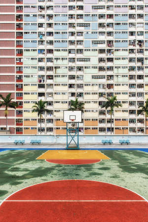 Photo for Choi Hung or literally `Rainbow Estate` is one of the oldest public housing estates in Hong Kong. Located in the Wong Tai Sin District of Kowloon, the old concrete apartments were built in the early 1960s. With a population of over 7 million, Hong Kong is one of the most densely populated areas in the world. - Royalty Free Image