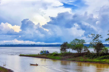 Small wooden canoes with an explosion engine called `peque peque` are the public transport that travel along the Amazon River in Leticia, Colombia.
