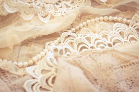 Photo pour Lace, pearls and chiffon vintage background - image libre de droit
