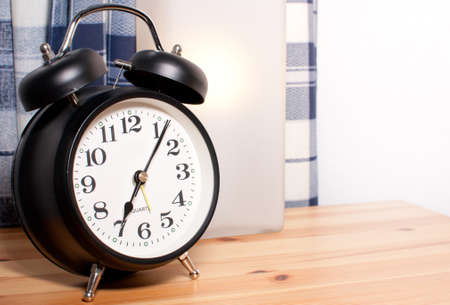 Alarm Clock and Reading Lamp on Bedside Table