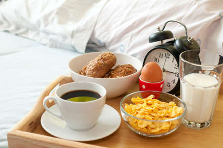 Breakfast in Bed - Rolls, Coffee, Boiled Egg, Milk, Corn Flakes and Alarm Clock