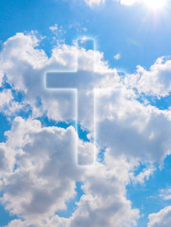 Silhouette of Cross on Blue Summer Sky With Clouds