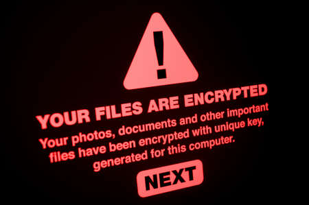 Photo pour Ransomware - Close up of Your Files Are Encrypted on the Screen - image libre de droit
