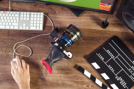 Photo pour Desktop shot of a modern Digital Cinema Camera and clapboard on stylish wooden desktop Workplace Background - image libre de droit