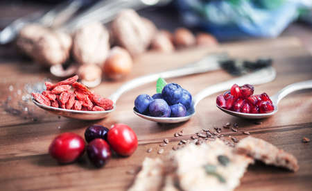 Foto für Superfood - Spoons of various superfoods on wooden background - Lizenzfreies Bild