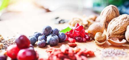 Foto für Superfood: variation of superfoods on wooden background - Lizenzfreies Bild