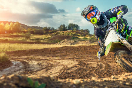 Arnoldsweiler, Germany, October 05,2017: Extreme Motocross MX Rider riding on dirt track on a sunny late summer day on public training session in preparation for motocross event.