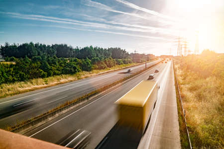 Photo pour Lots of Trucks and cars on a Highway - transportation concept - image libre de droit
