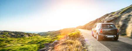 Photo pour rental car in spain mountain landscape road at sunset - image libre de droit