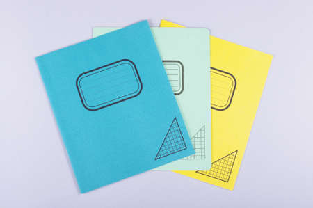Three exercise books isolated on the gray background