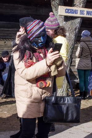 KAUNAS, LITHUANIA - FEBRUARY 25: Woman with mask in carnival of Uzgavenes on Feb 25, 2017, Kaunas, Rumsiskes, Lithuania