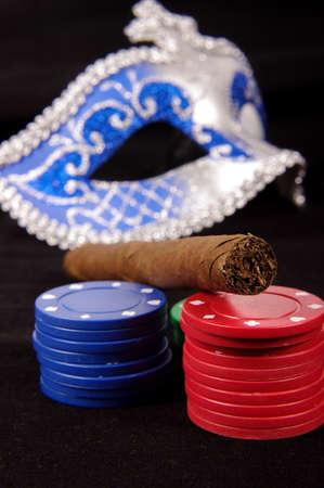 Poker chips domino mask and cigar gambling concept