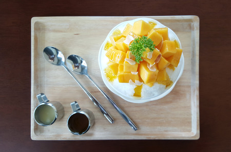 Mango with shaved ice milk flavour serving with syrub