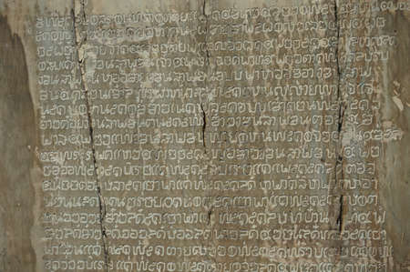 Closeup of Thai ancient stone inscription at Sukhothai province .