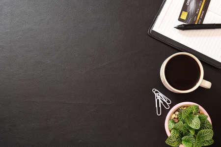 Photo pour Notebooks, credit cards and coffee mugs - image libre de droit