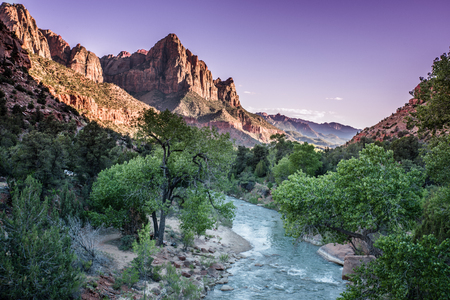 Watchman In Purple Sunset Rays in Zion National Park, United States