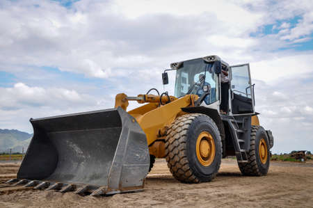 Photo for bulldozer performing job, in the construction site, Myanmar - Royalty Free Image