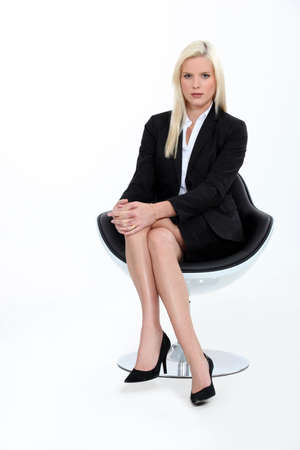 Studio shot of a blonde businesswoman in a suit
