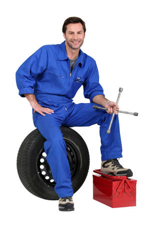 Mechanic with tyre and tools