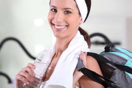 Woman with bag leaving gym