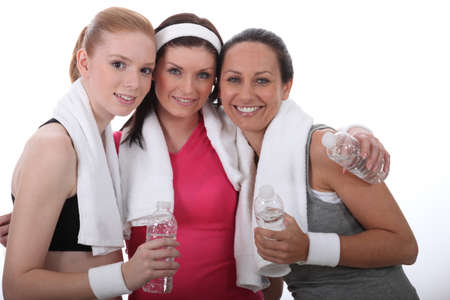 Gym buddies with bottles of water
