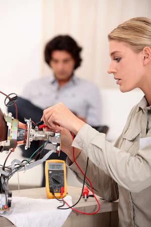 Woman repairing television