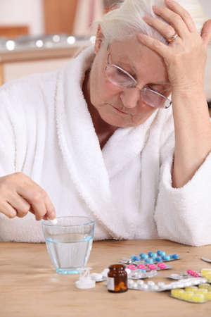 senior woman taking her pills