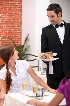 waiter serving a table
