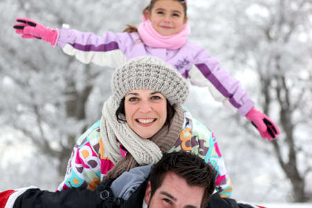 Family having fun outdoors on a cold winter