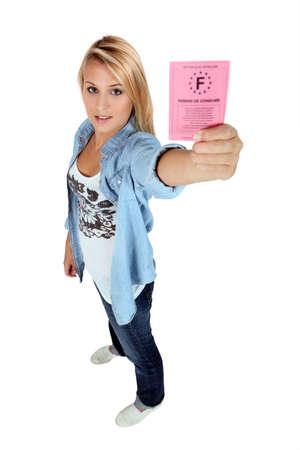 girl holding driving license