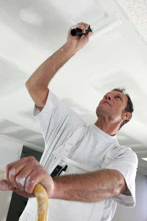 Photo pour Painter in room under construction - image libre de droit